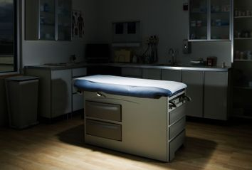 Empty doctor examination room
