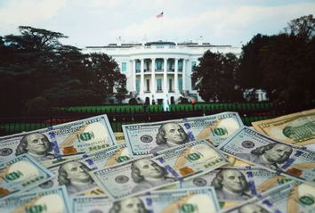 U.S. dollar banknotes and an image of White House