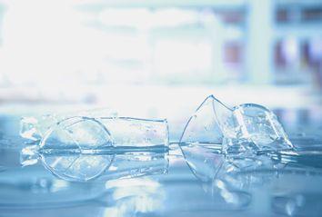Broken beaker glass in science laboratory