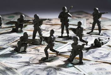 Toy soldier fighting on money