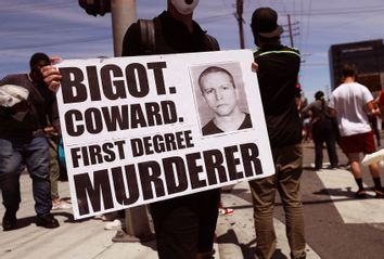 A protester holds a sign with a photo of former Minneapolis police officer Derek Chauvin