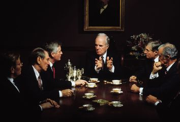 Rich old men in a meeting