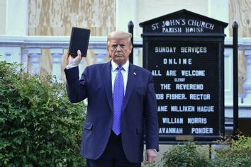 US President Donald Trump holds up a Bible