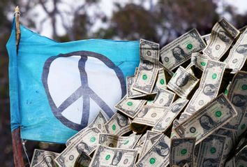 Peace flag, covered up by money