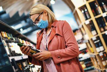 Young woman choosing wine