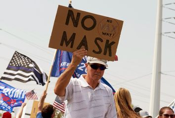 Protesters rally against a mask mandate