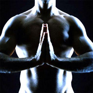 A priest on his knees | Salon com