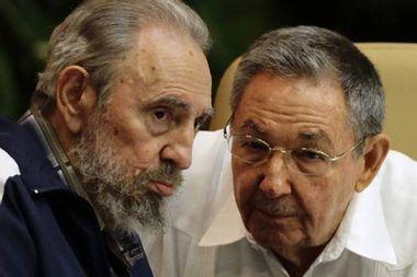 Former Cuban leader Fidel Castro and Cuba's President Raul Castro