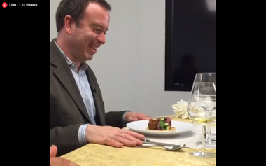 Image for Washington Post columnist Dana Milbank is for real eating a newspaper live on Facebook right now
