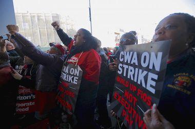 Communications Workers of America (CWA) workers striking against Verizon cheer as U.S. Democratic presidential candidate and U.S. Senator Bernie Sanders speaks to them in Brooklyn