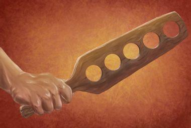 Hand brandishing a paddle