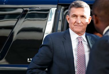 Michael Flynn's sentencing delayed after judge tells ex-Trump staffer he may not avoid incarceration