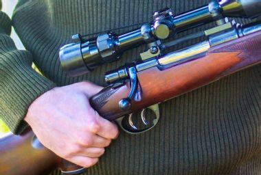 Guy Holding Rifle