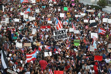 Thousands of Puerto Ricans take to the streets to demand embattled governor resign
