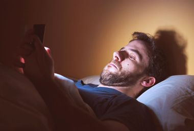 Man looking through apps on his smartphone