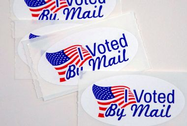 """Stickers that read """"I Voted By Mail"""""""