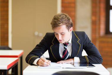 High school boy in uniform in classroom
