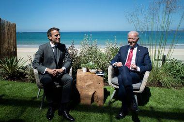 U.S. President Joe Biden and French President Emmanuel Macron speak at a G7 summit on June 12, 2021.