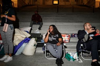 Rep. Cori Bush speaks with supporters as she spends the night outside the U.S. Capitol to call for for an extension of the federal eviction moratorium on July 31, 2021.