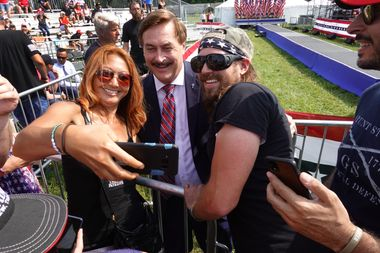 Supporters of former President Donald Trump take a selfie with My Pillow founder Mike Lindell