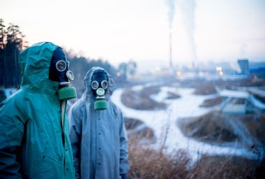 A portrait of people in gas masks in bad ecology