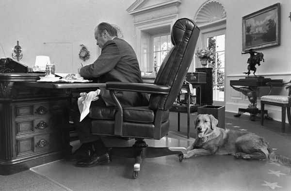 President Gerald Ford and his pet dog Liberty in the Oval Office.
