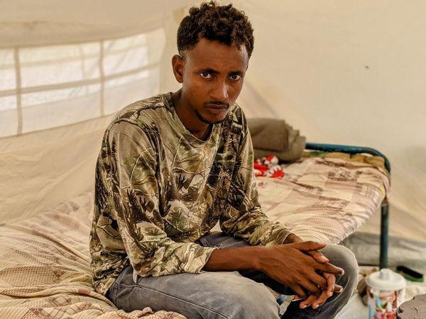 Ashanafe Syoum, 27, a Tigrayan man who escaped from Humera