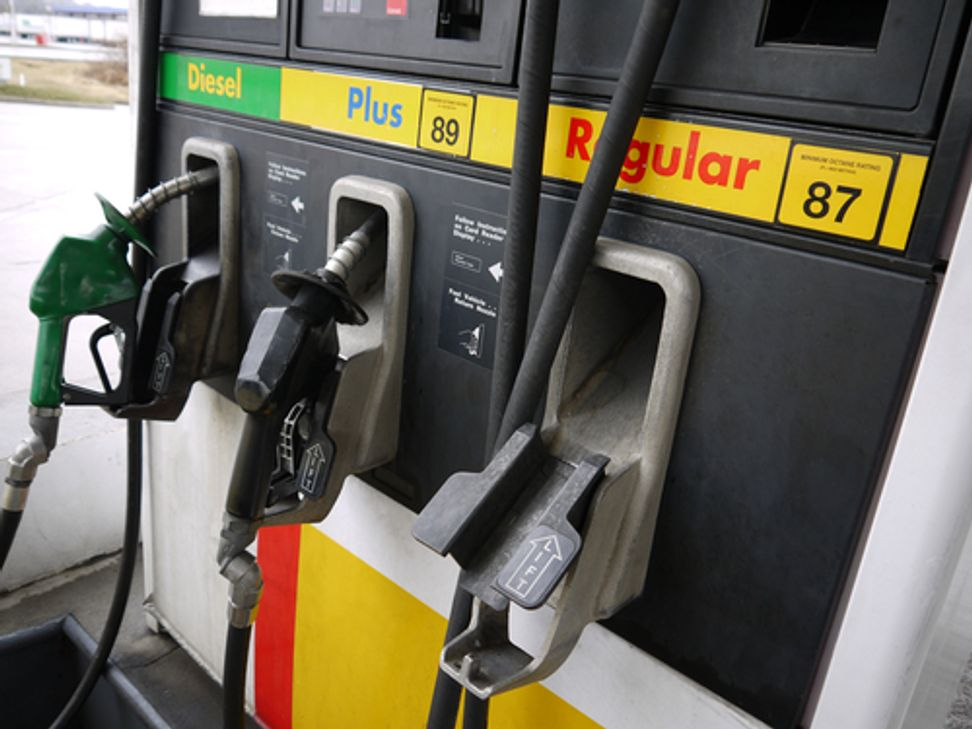 Gas pump warning labels would caution drivers to fill up at the planet's risk