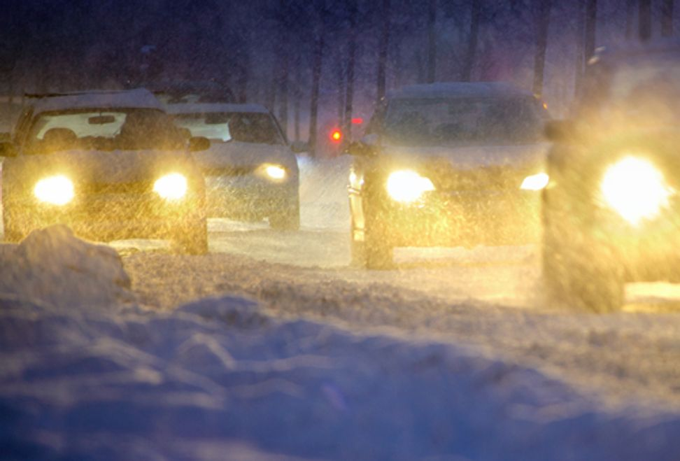 Unseasonably harsh weather kept a quarter of a million Americans home from work last month